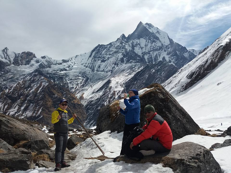 Pasang and two of his clients taking a rest during their trek