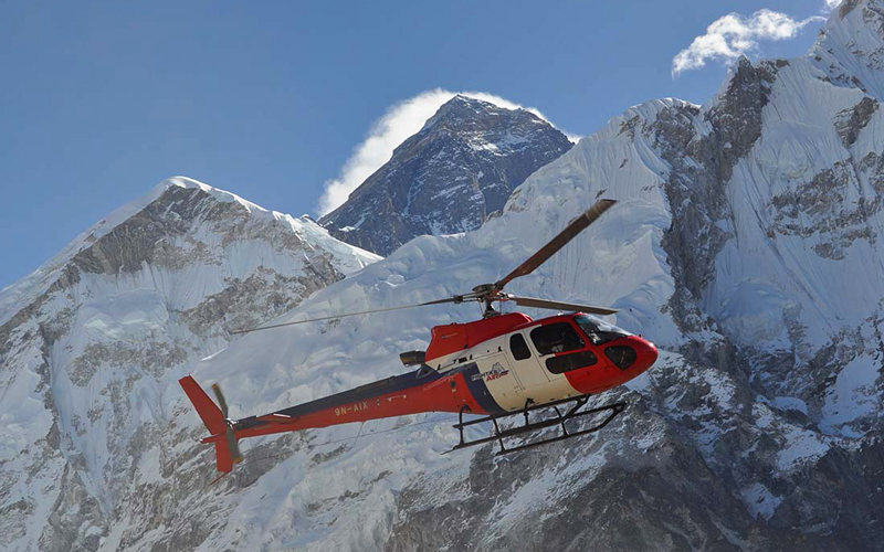 Helicopter flying with mount Everest in the backdrop