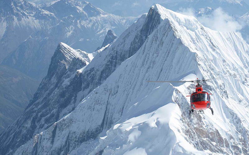 Helicopter flying over the Himalayas